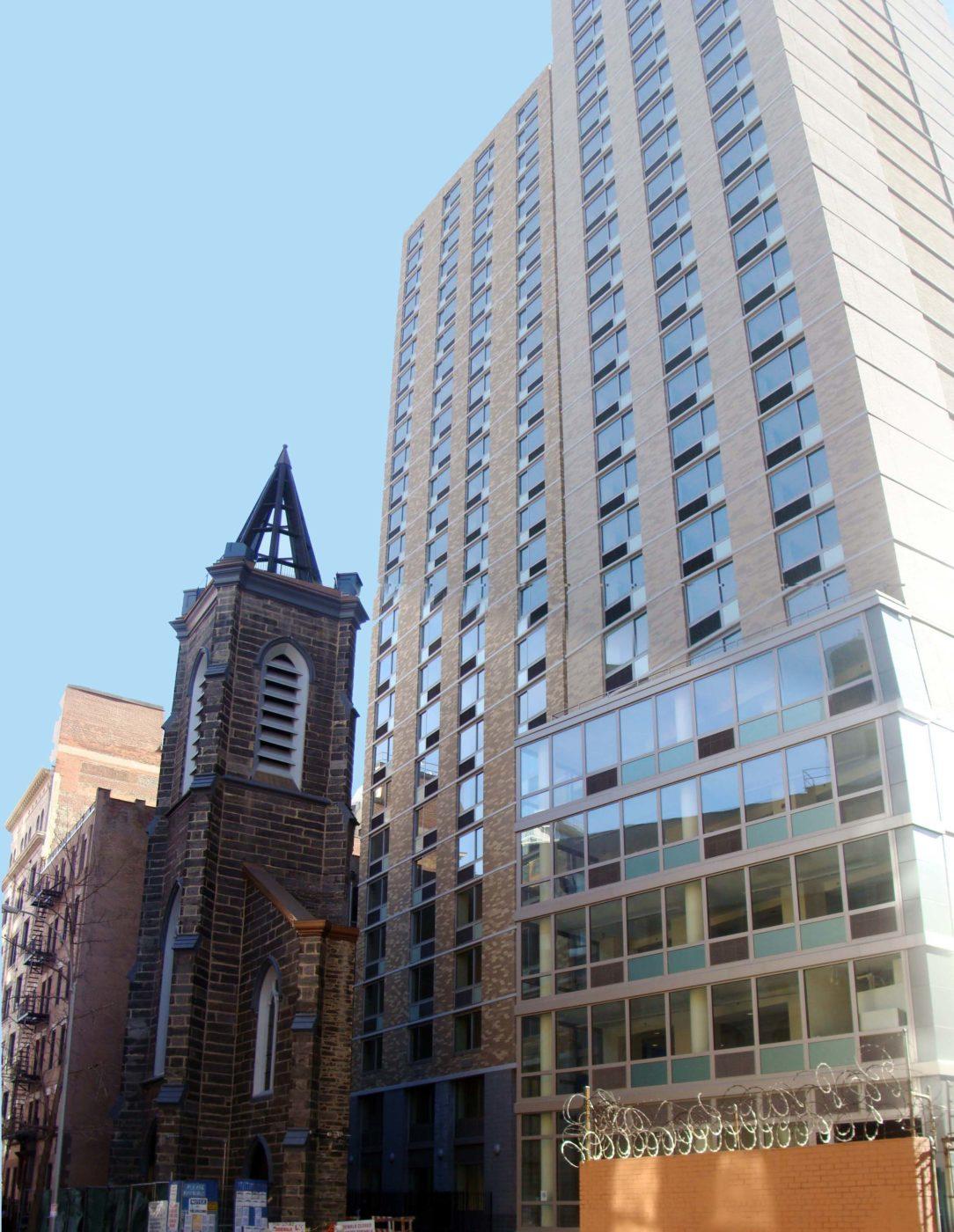 Facade of St. Ann's Church with NYU dorm behind it