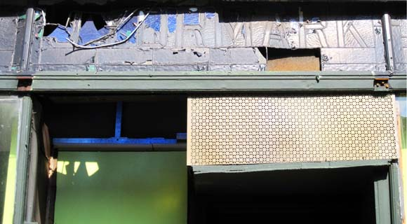 """A stained-glass sign reading """"J Yormark Shoes"""" is discovered during a storefront renovation at 15 8th Avenue."""