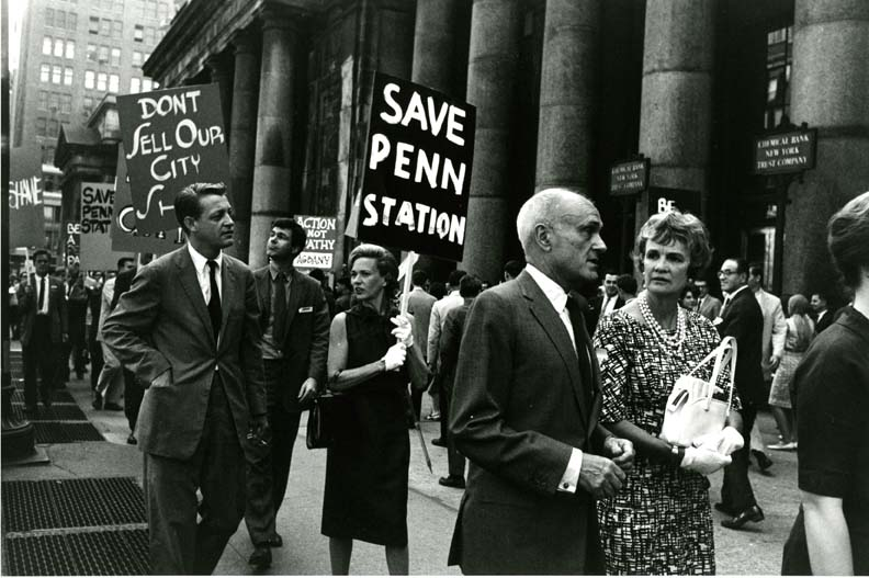 Architect Philip Johnson and Aline Saarinen march in protest of the impending demolition of Penn Station.