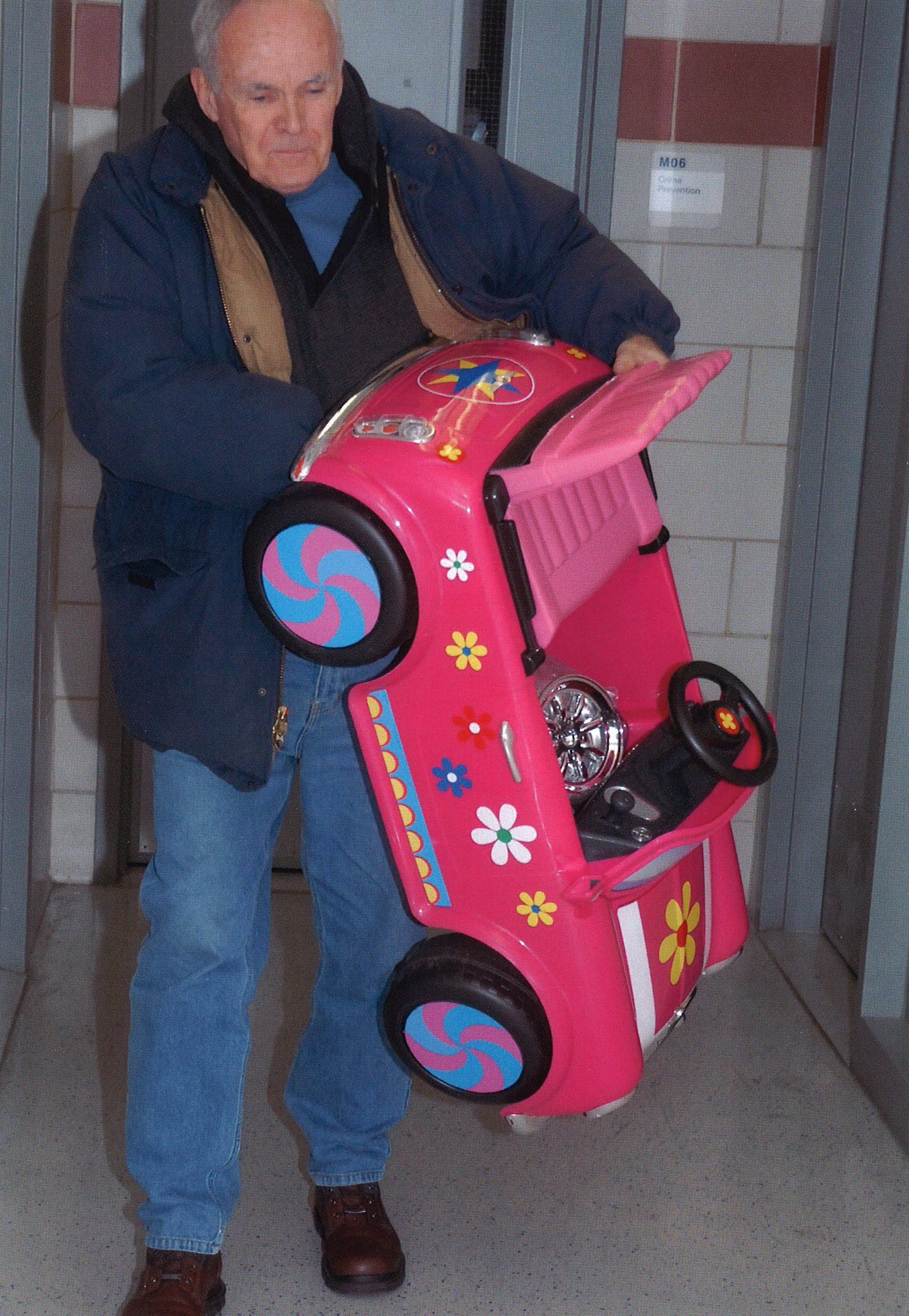 As head of  the 9th Precinct Community Council for twenty years, Jeremiah Shea instituted many community-centered event. He is pictured here bringing in one of the many toys collected though the precinct's toy drive.