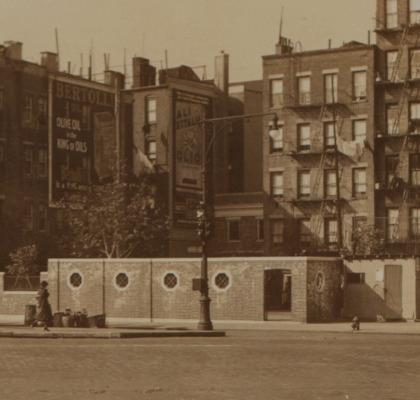 This walled entrance to The Downing Street playground can now be found inside Sir Winston Churchill Square. Photo via the NYPL.