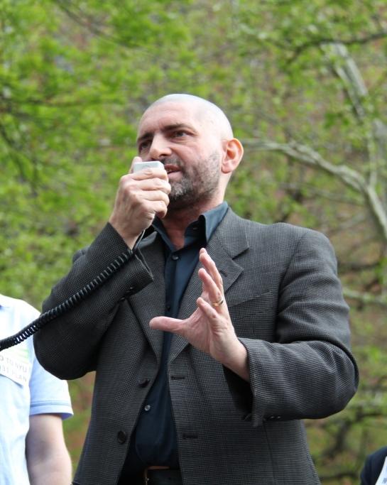 NYU Professor Patrick Deer speaking on behalf of NYU FASP at a rally in Washington