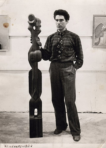 """Chaim Gross with his sculpture """"The Lindbergh Family,"""" 1932. Image courtesy of the Renee and Chaim Gross Foundation."""