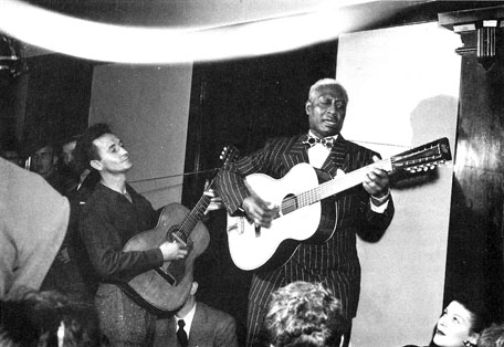 Lead Belly and Woody Guthrie.
