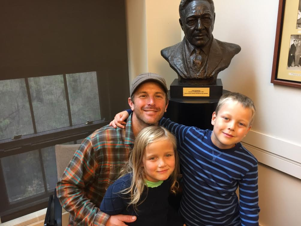 Eliot Lothrop, Arthur G. Hays' great-grandson, with his own children and a bust of Arthur at the NYU Law School.
