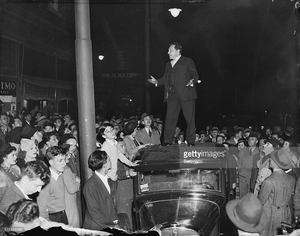 May 18, 1946 - Jersey City. Pictured on top of an automobile as he addressed some 200 persons in Jersey City. Mentioning in his speech that he had no permit, Hays invited police to arrest him and make a test case of Mayor Frank Hague's ban on public speakers.
