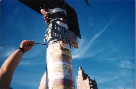 Lenore Mills- Carol Hanging the Hero Highway Sign, September 11, 2002