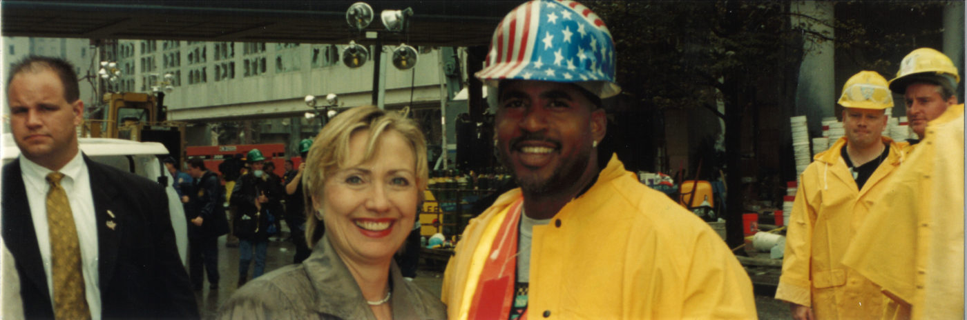 Hillary Clinton with worker at Ground Zero