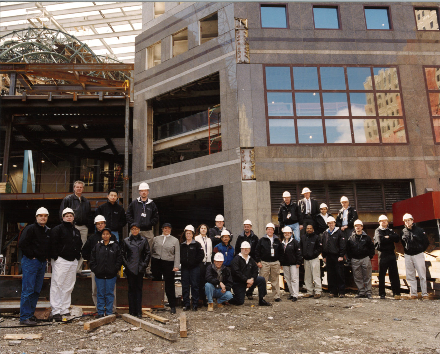 Sonny Deluccy (kneeling) and crew in front of Brookfield Place one year later