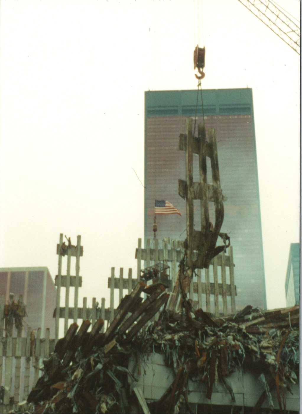 Crane Lifting Debris at Ground Zero with One Liberty Plaza Sheathed in the Background