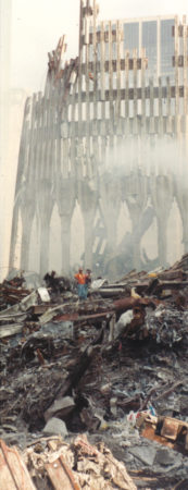 Workers Standing on Debris with the Destroyed Exoskeleton of 2 World Trade Center