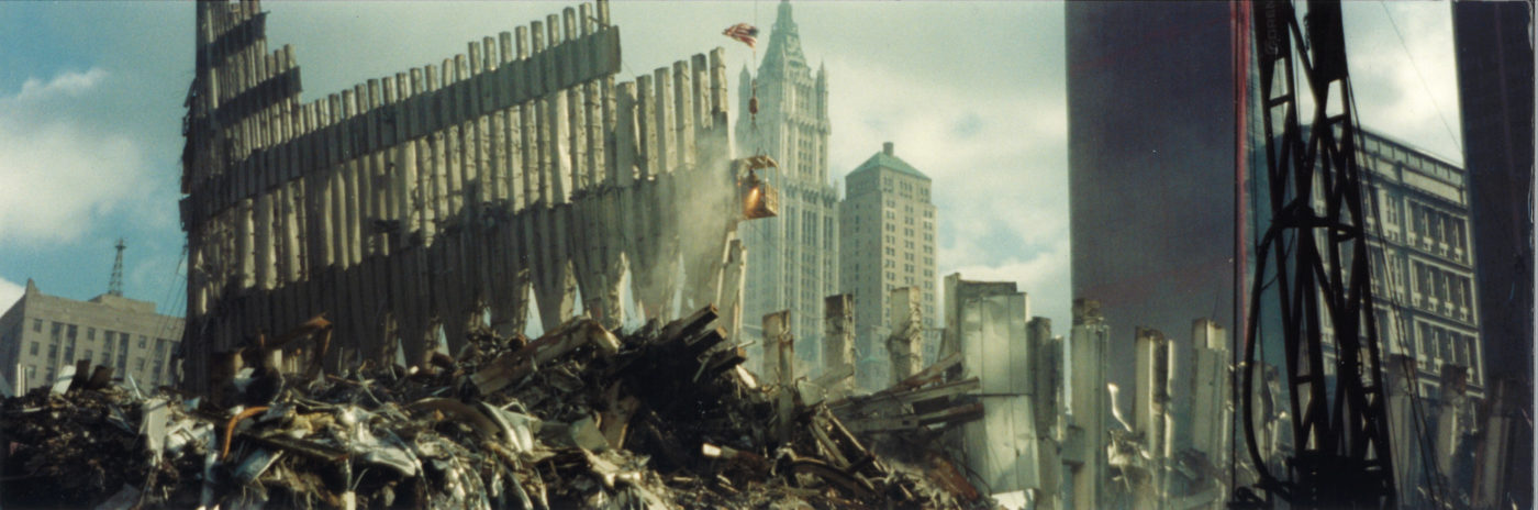 Debris and Destroyed Facade with the Woolworth and the Transportation Building in the Background