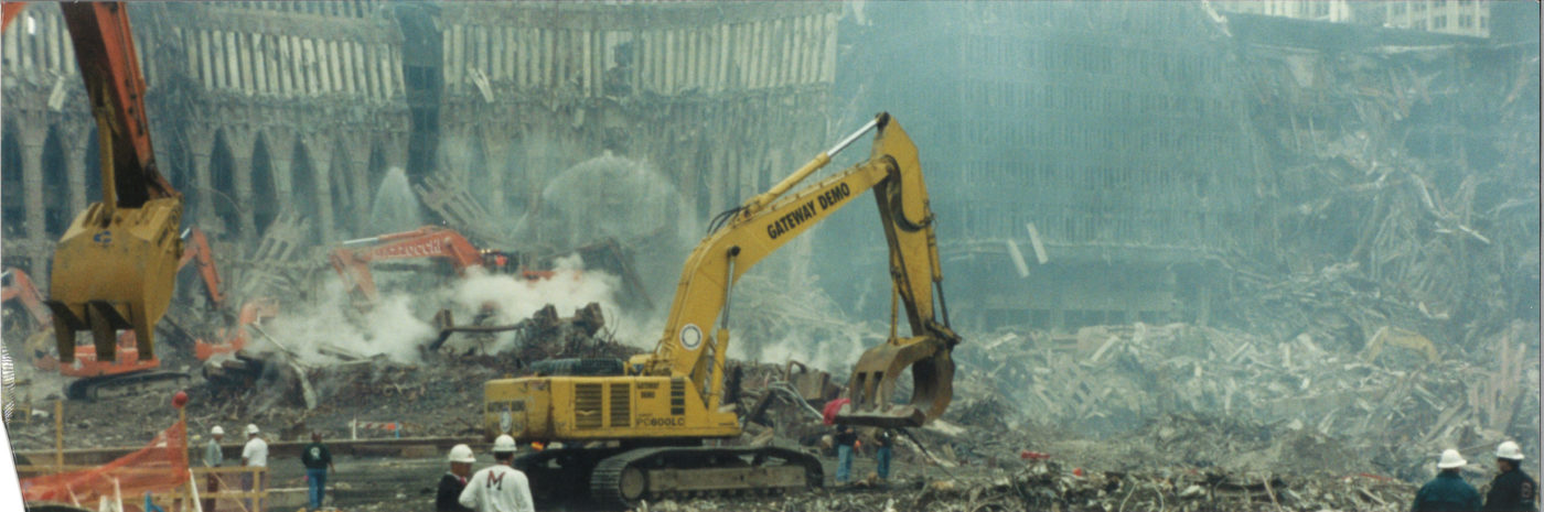 Diggers Working at Ground Zero with Workers, Debris, and Smoke Visible