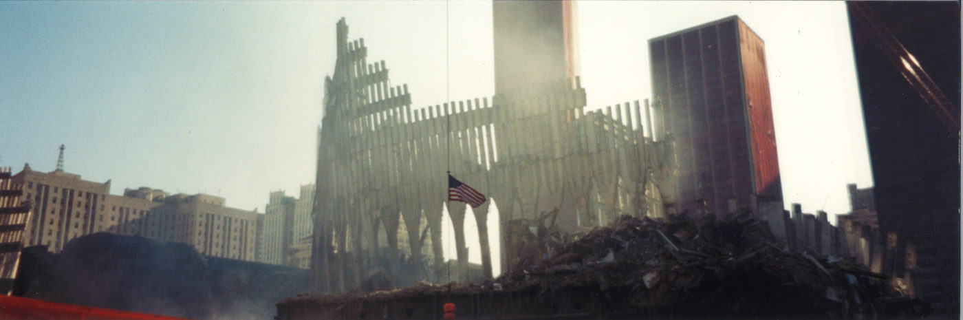 Destroyed Facade of Tower Two with the Flag Blowing
