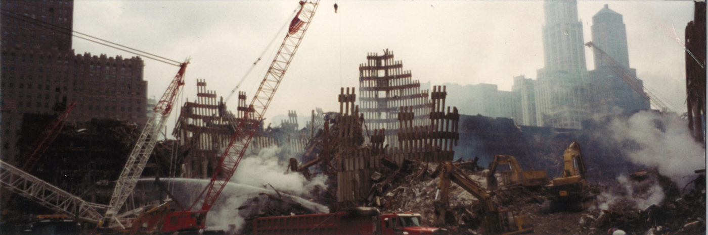 Destroyed Facades with Cranes and Smoke in the Foreground