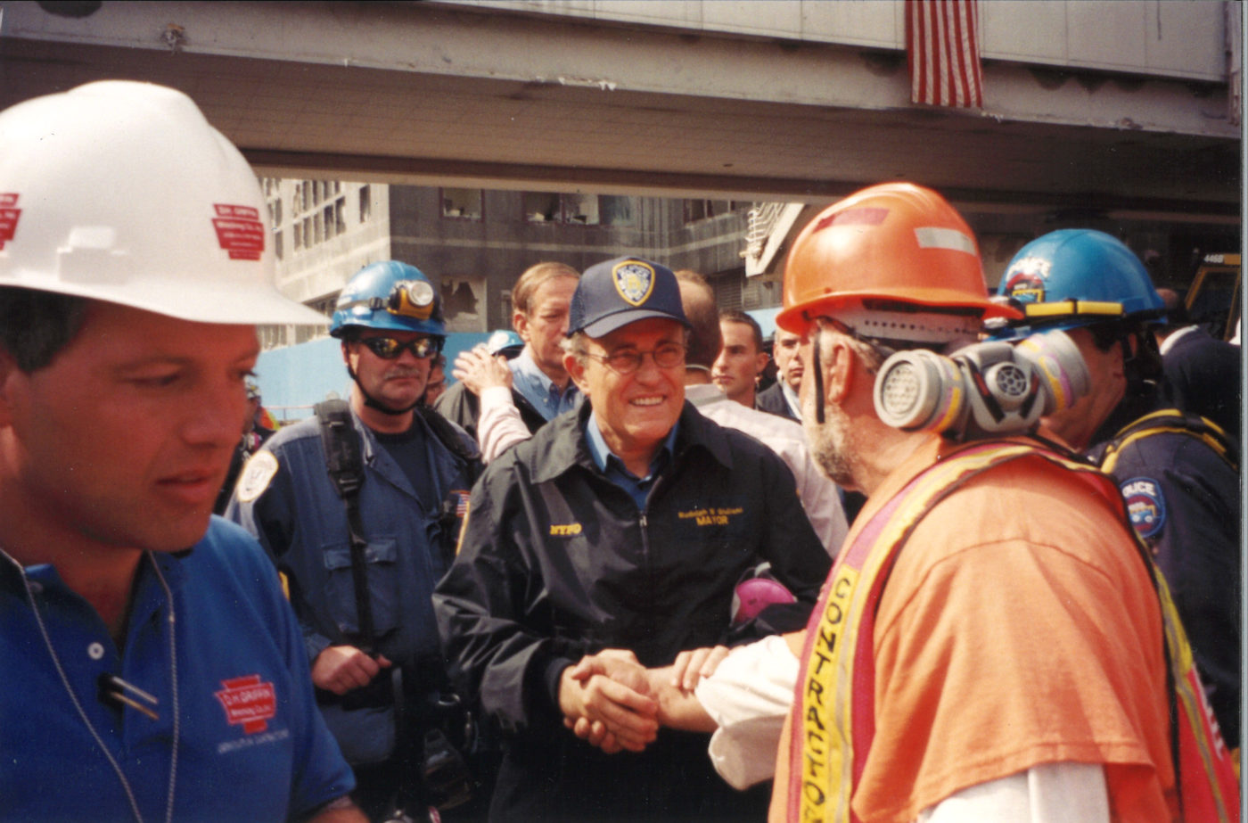 Unknown Workers Shaking Rudy Guilian's Hand