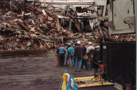 A Group of Workers Standing Beside Debris at Ground Zero