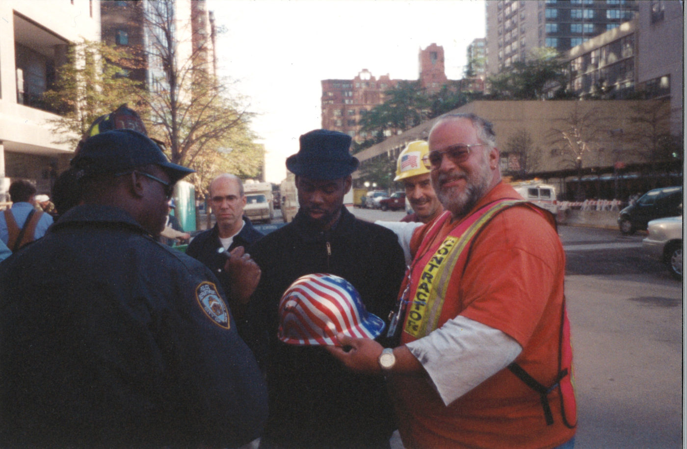 Chris Rock Signing Hard Hats of Unknown Workers at Ground Zero
