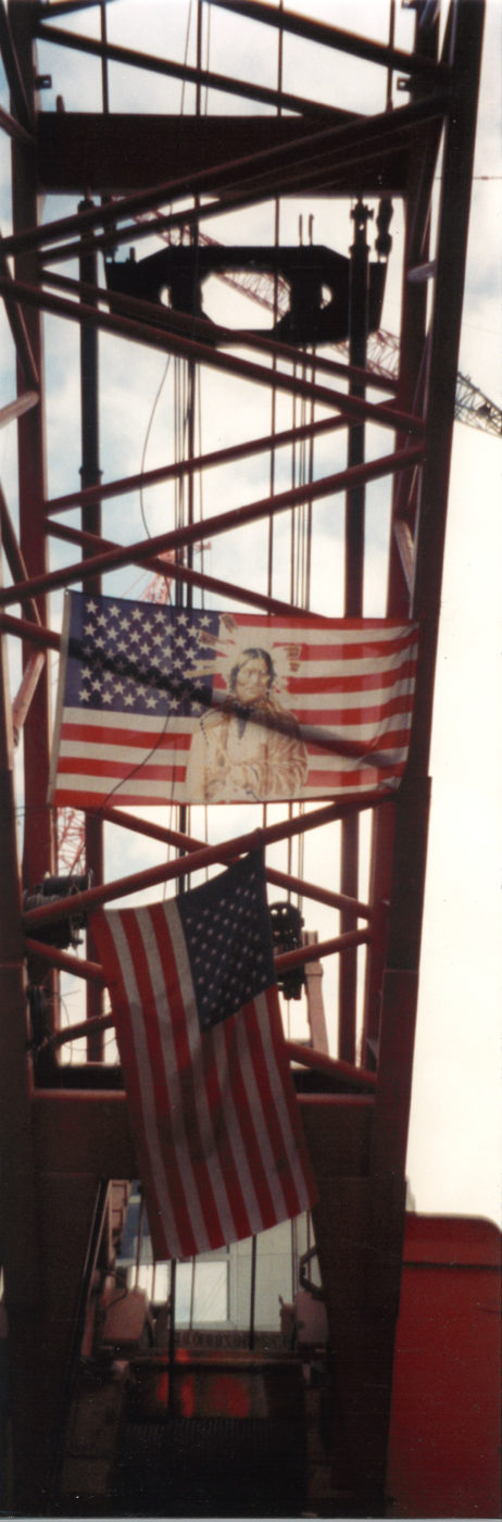 Closeup of American Flag and an American Flag with a Native American on it