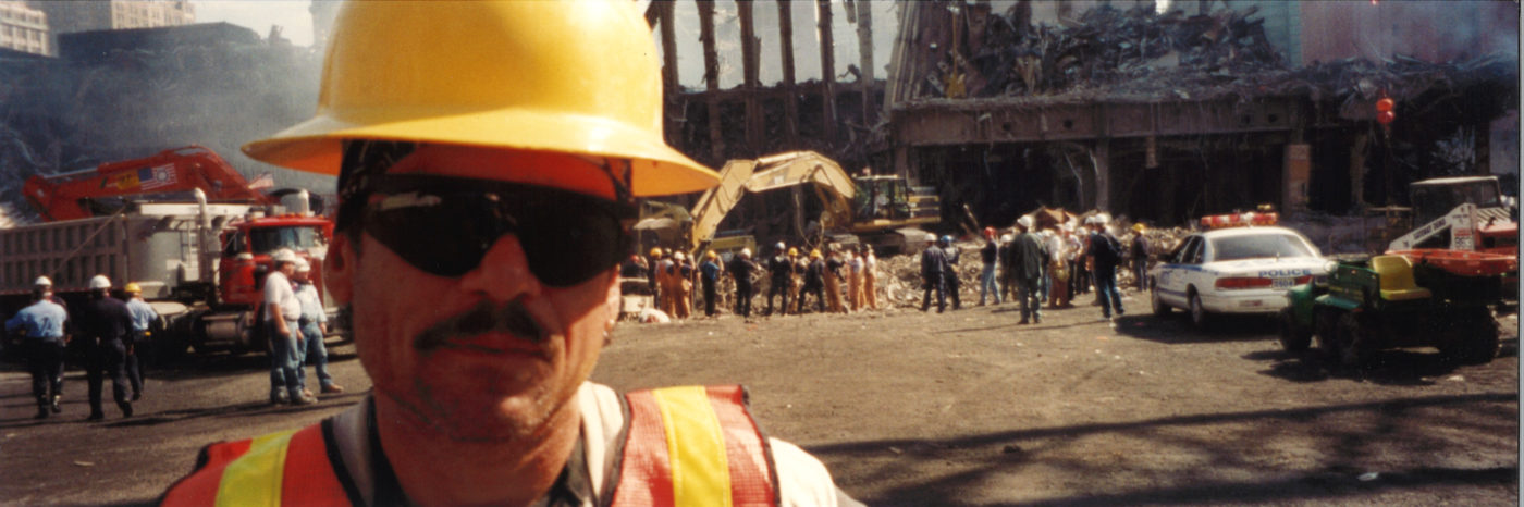 Closeup of an Unknown Worker Wearing a Hard Hat and Sunglasses at Ground Zero