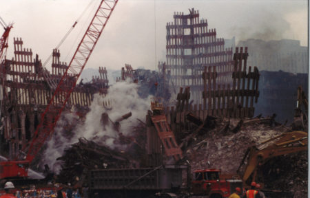 Crane and Men Working with the Falling Structure of the WTC