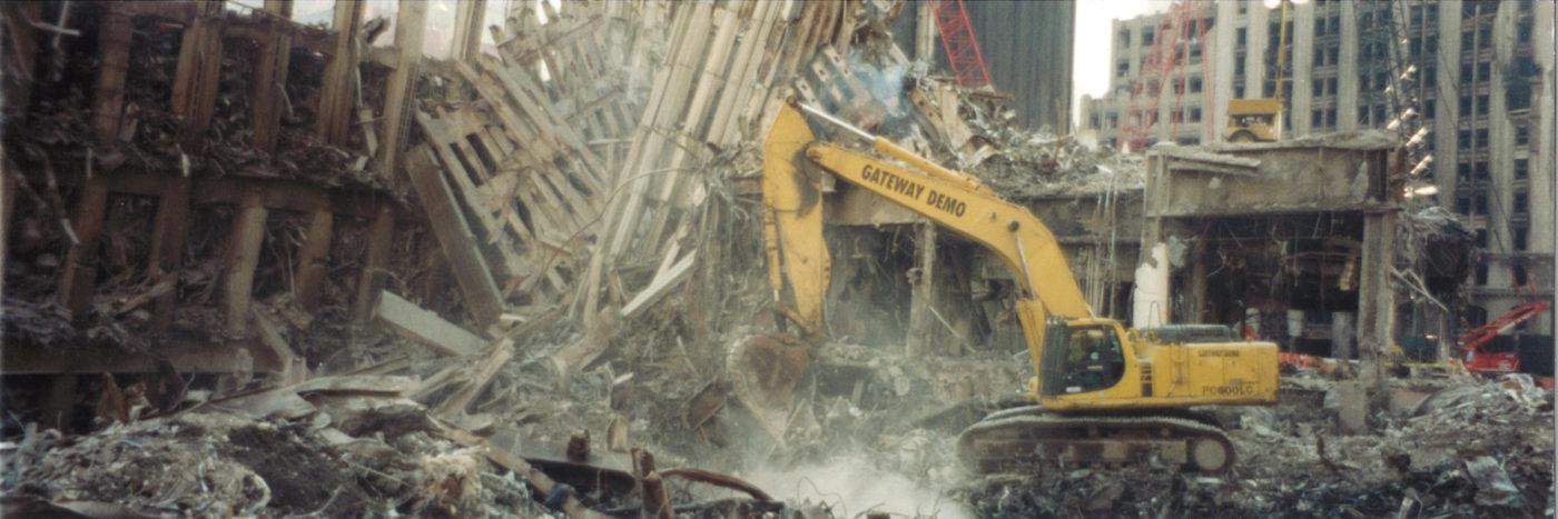 Crane Digging Through Debris at Exoskeleton