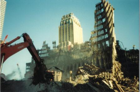 Crane Excavating Debris with 140 West Street in the Back