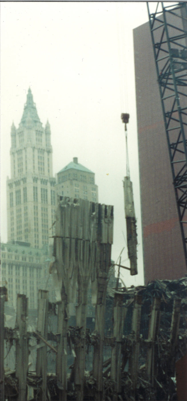 Crane Moving Steel from the Exoskeleton of the WTC with the Woolworth int he Back