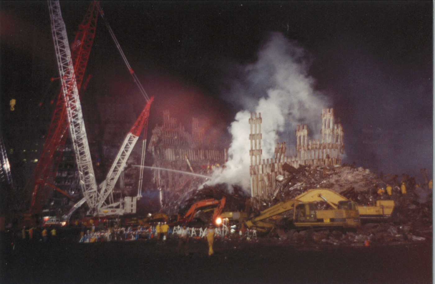 Cranes and Diggers beside Smoke Rising through destroyed Exoskeleton