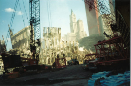 Cranes Pulling Down the Exoskeleton of the WTC with the Woolworth in the Back