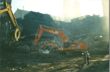 Cranes Sifting Through Debris with Destroyed WTC 5 and 6 in the Back