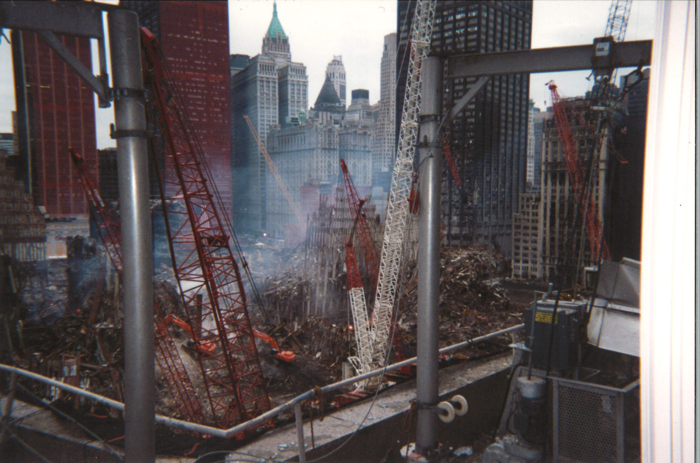 Cranes working in Rubble with Surrounding Buildings