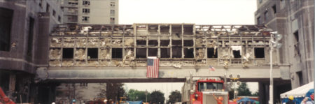 Destroyed Over Pass at Ground Zero with the Flag Hanging on it