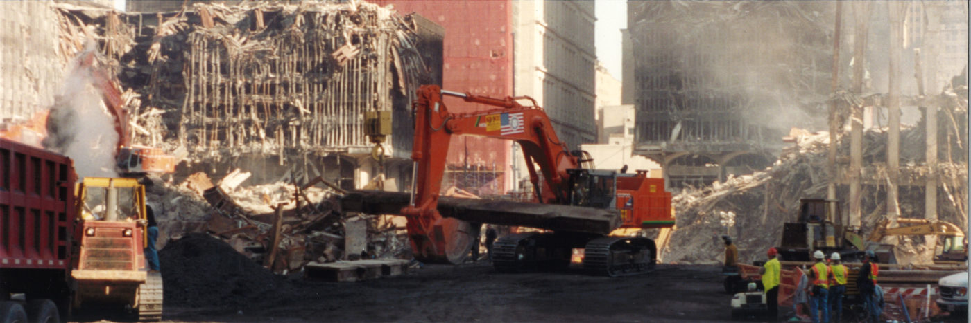 Digger Moving a Large Steel Beam at Ground Zero