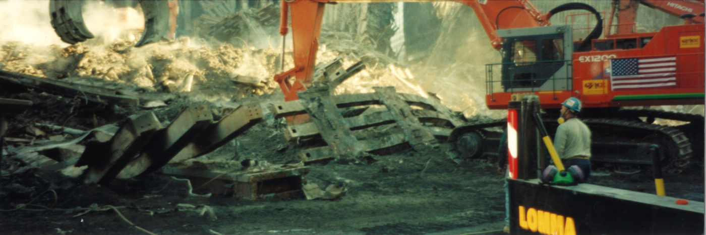 Digger Moving Steel Piece of the WTC