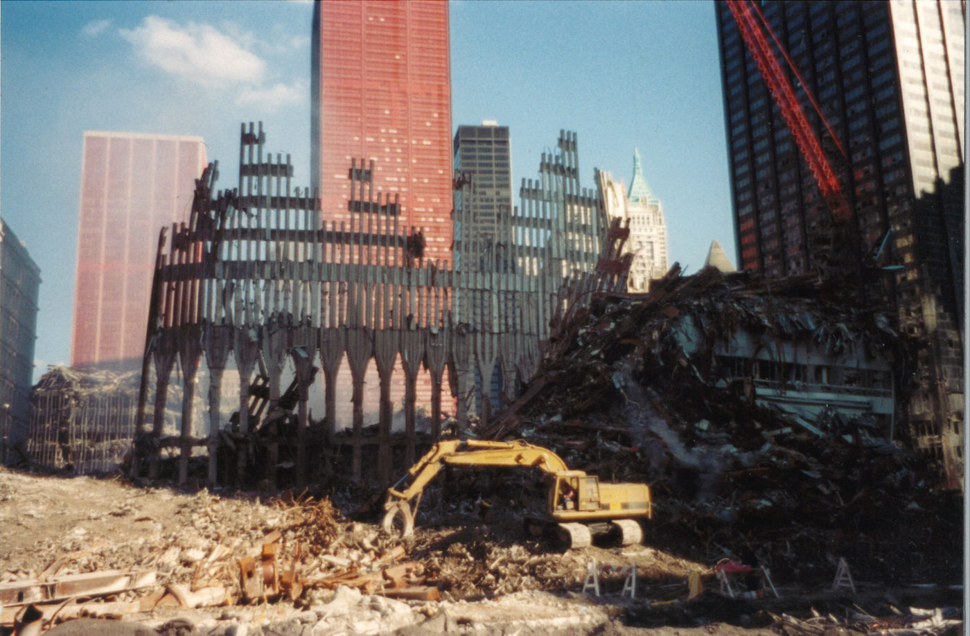 Digger Working to Clear Debris at Ground Zero in Front of the WTC Exoskeleton