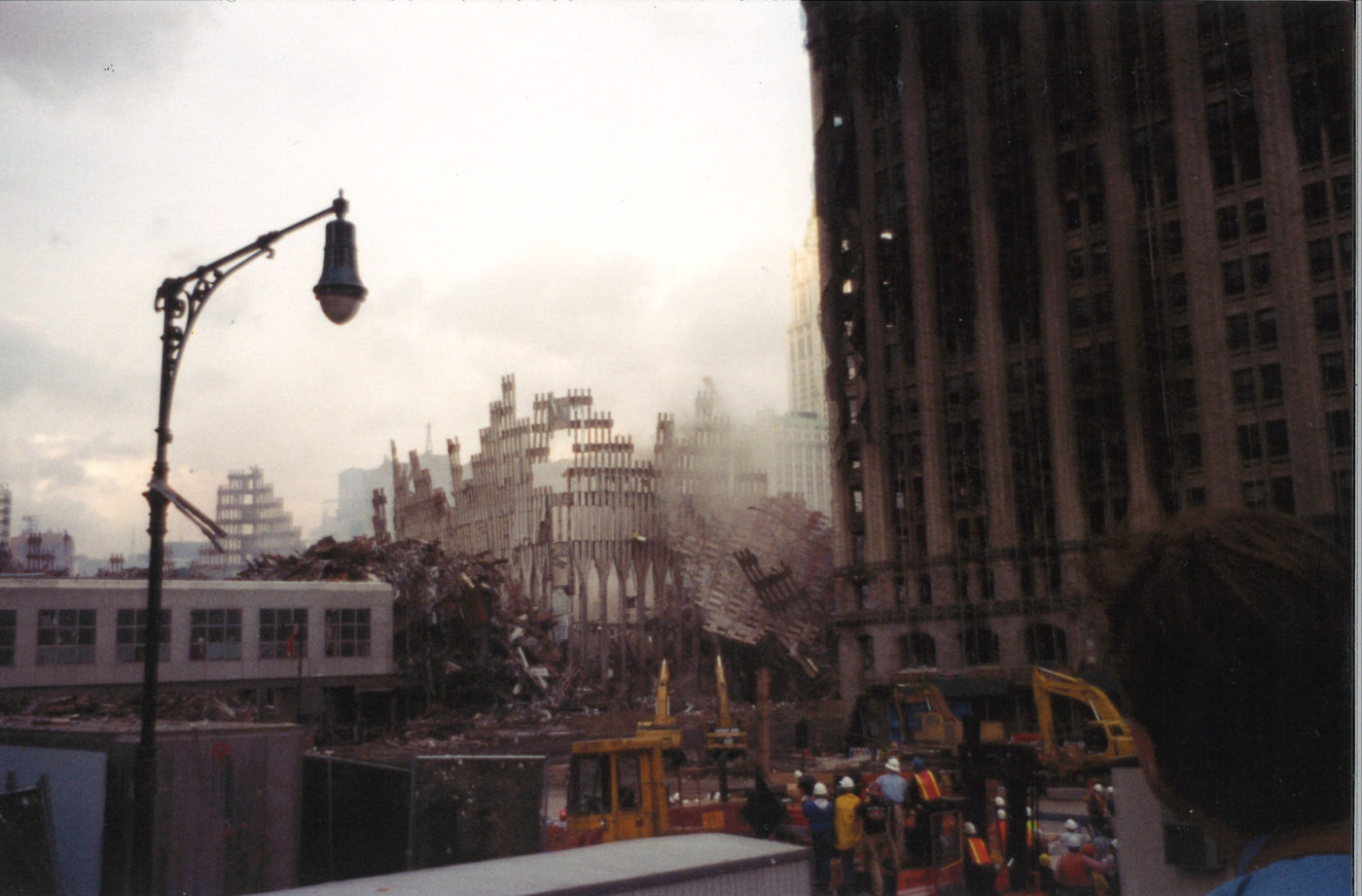 Fallen Exoskeleton with Damaged 90 West Street to the Right