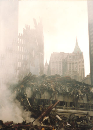 Falling Debris and Smoke with the Equitable Building and 40 Wall Street in the Back