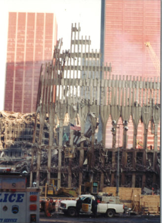 Falling Exoskeleton in front of Sheathed 22 Cortlandt St and One Liberty Plaza (l. to r.)