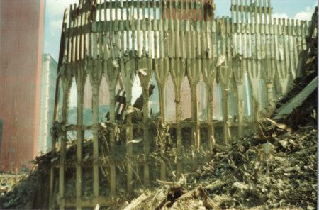 Falling Exoskeleton of WTC at Ground Zero surrounded by Debris