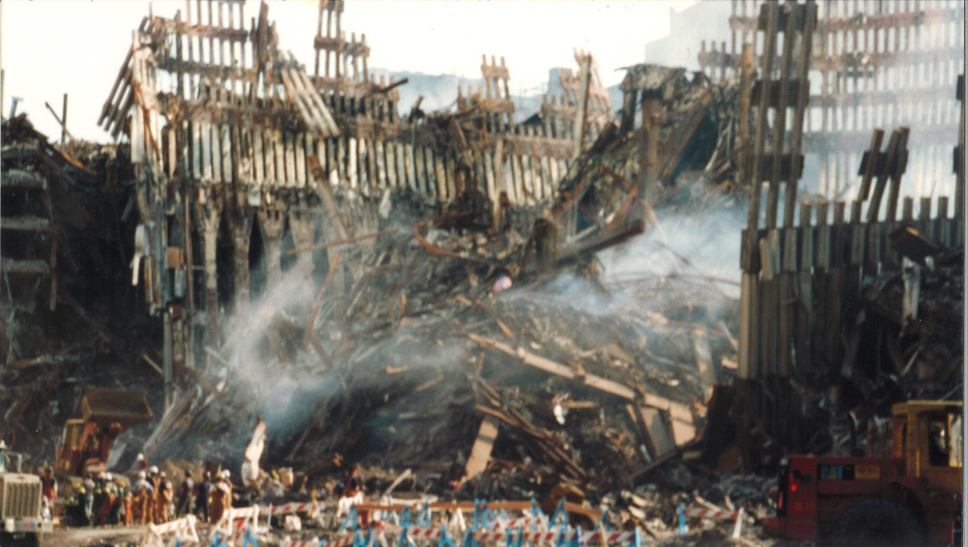 Falling Exoskeletong and Debris Covered in Smoke at Ground Zero