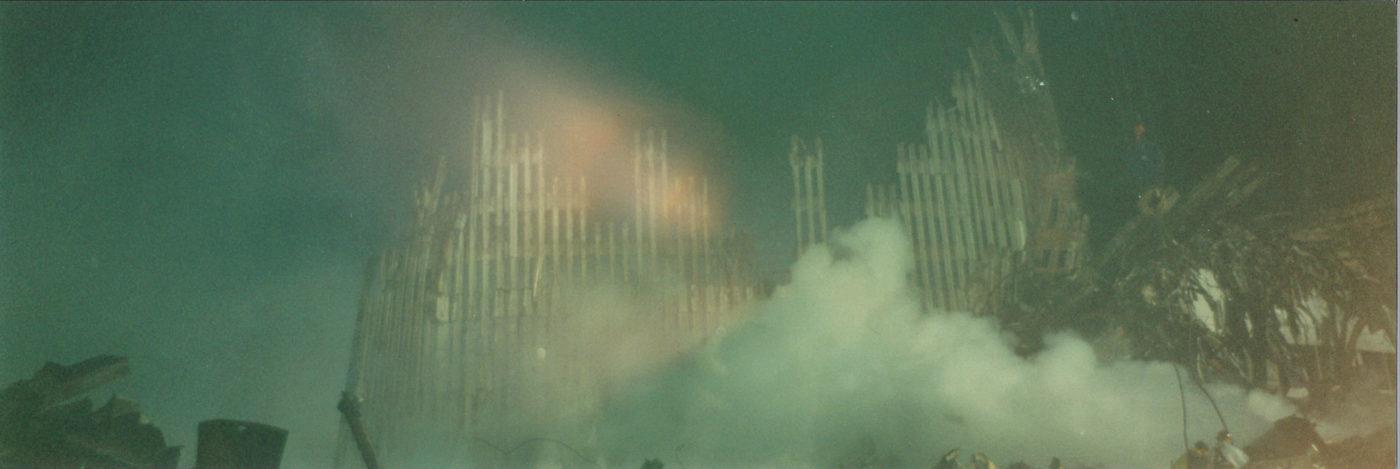 Falling WTC Exoskeleton surrounded by Smoke at Night