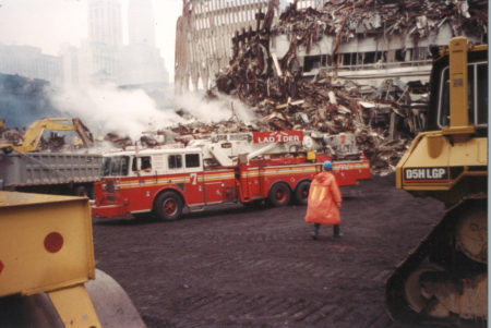 FDNY Ladder 7 from East 29th Steet in frot of the damaged Marriot Hotel and Tower 2