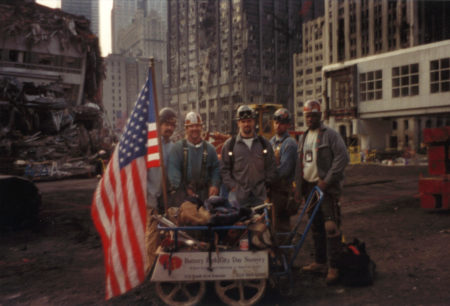 Five Unknown Workers Stand with Battery Park City Cart with a Flag