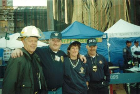 Four Unknown NYPD take a photo at Ground Zero
