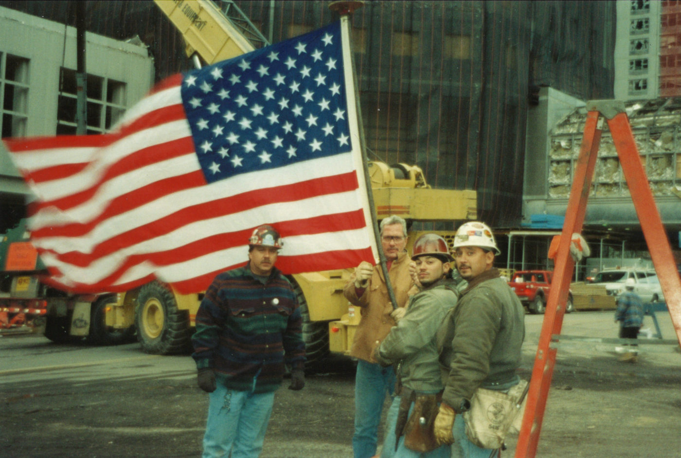 Four Unknown Workers Fly the Flag