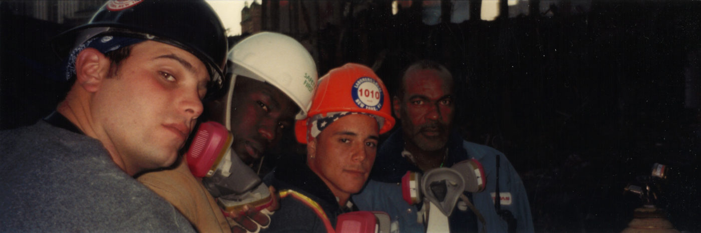 Four Unknown Workers Take Photo at night at Ground Zero, one wearing a hat from local Laborers Union 1010