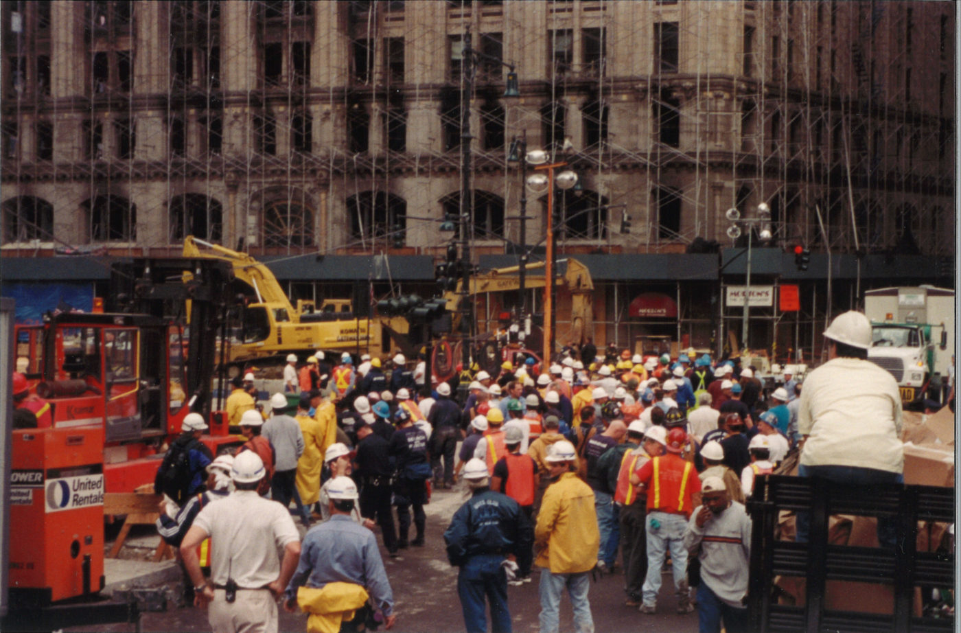 Group of Workers in front of 90 West Street with Scaffolding