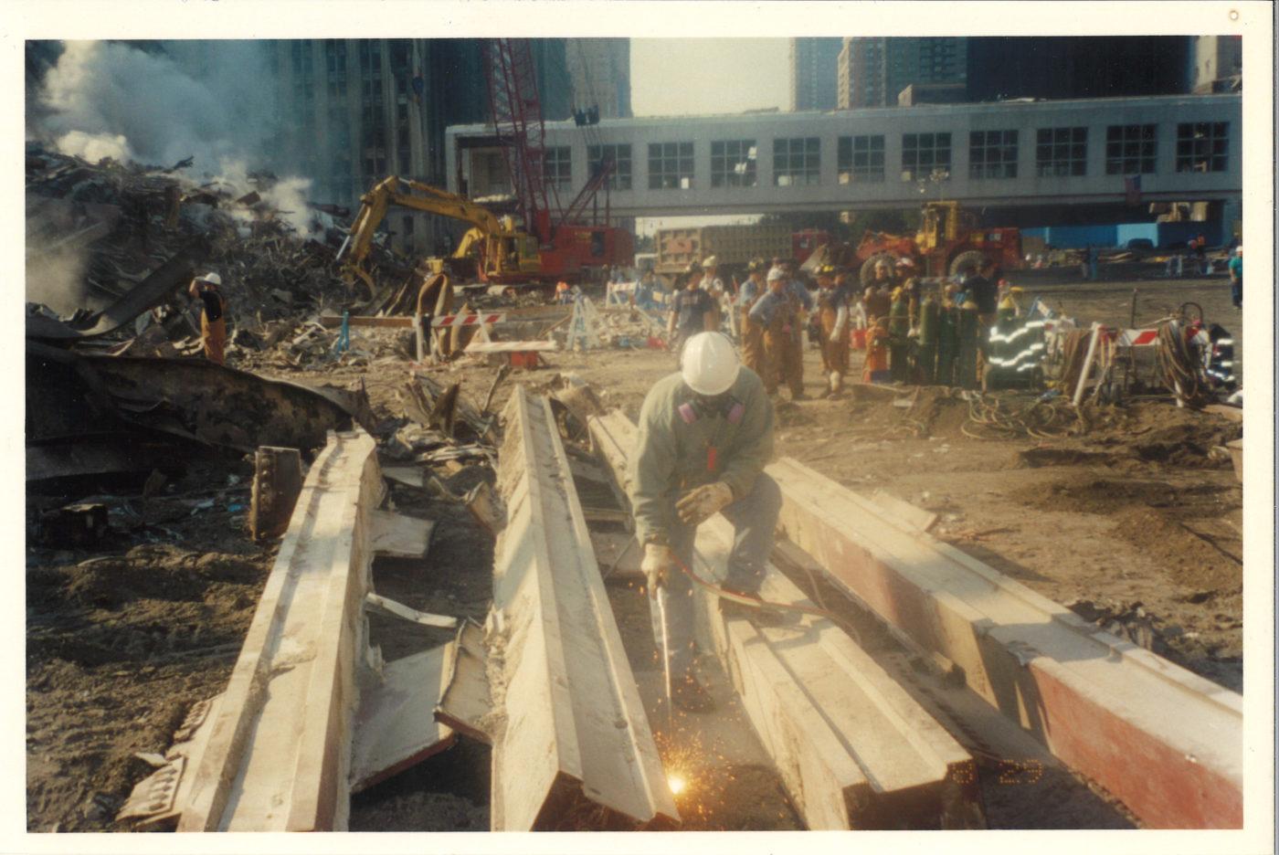 Iron Worker Breaking Steel Plates