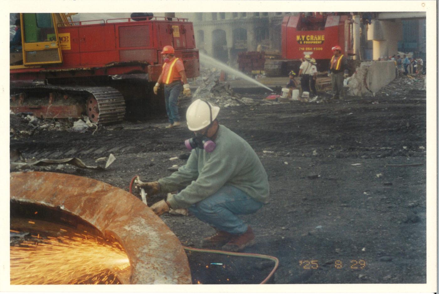 Iron Worker Cutting Through Steel Beam